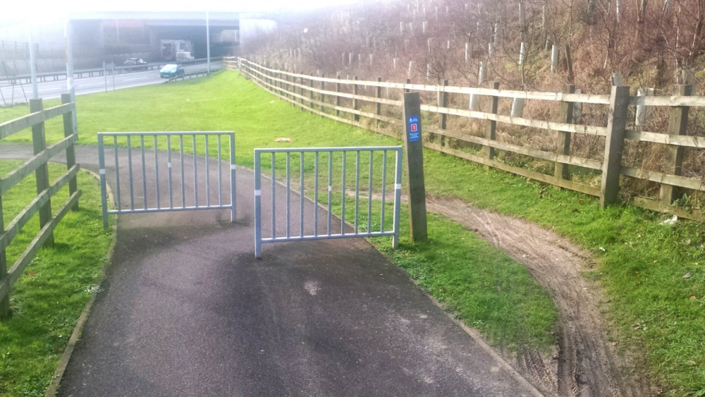 Problem not solved. Gate to slow cyclist on a track, showing how cyclists avoid it by going round the gate